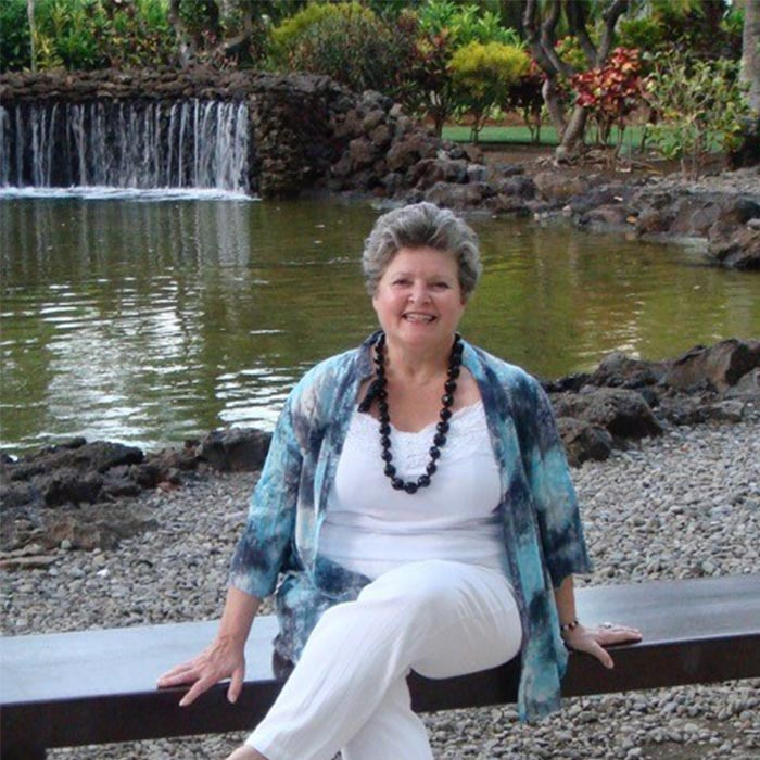 Louise LeBrun sitting on a bench in Hawaii